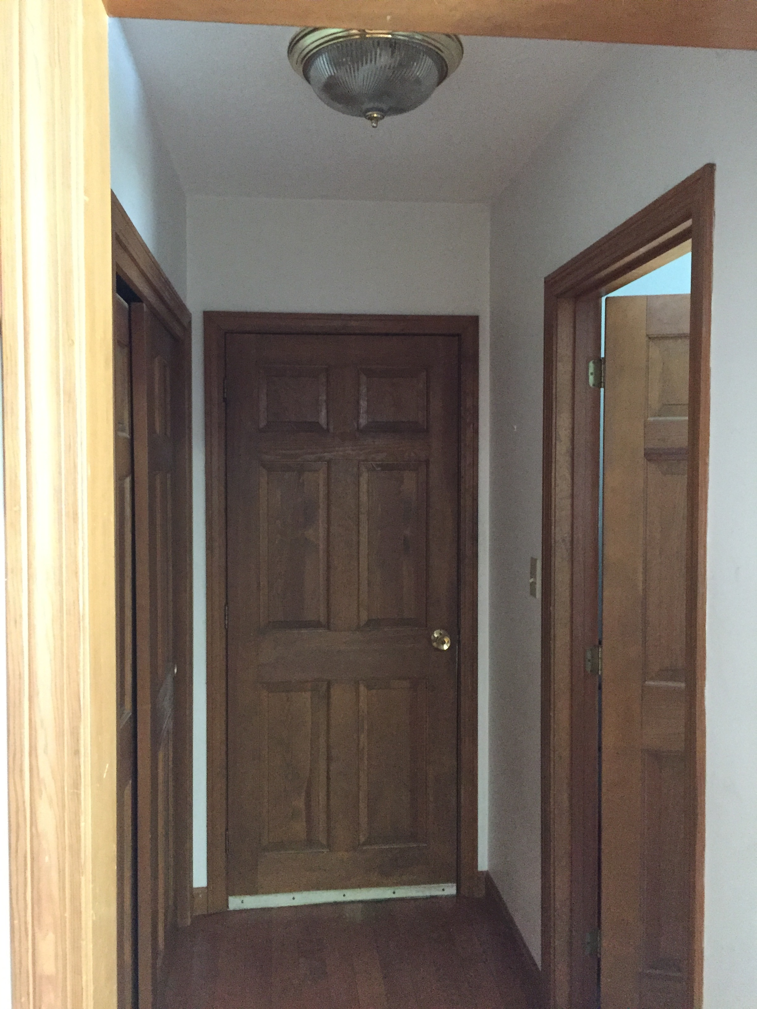 Before - Coat Closet and Hall to Garage, Powder Room on Right