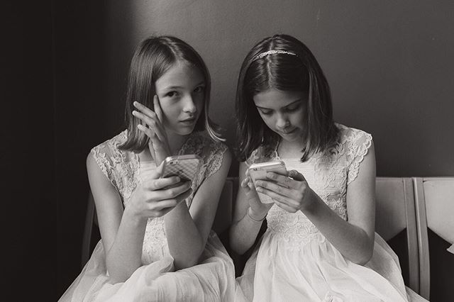 Wedding photography isn't always about killer couple photos. This portrait of two flower girls checking their phones remains one of my all times faves.