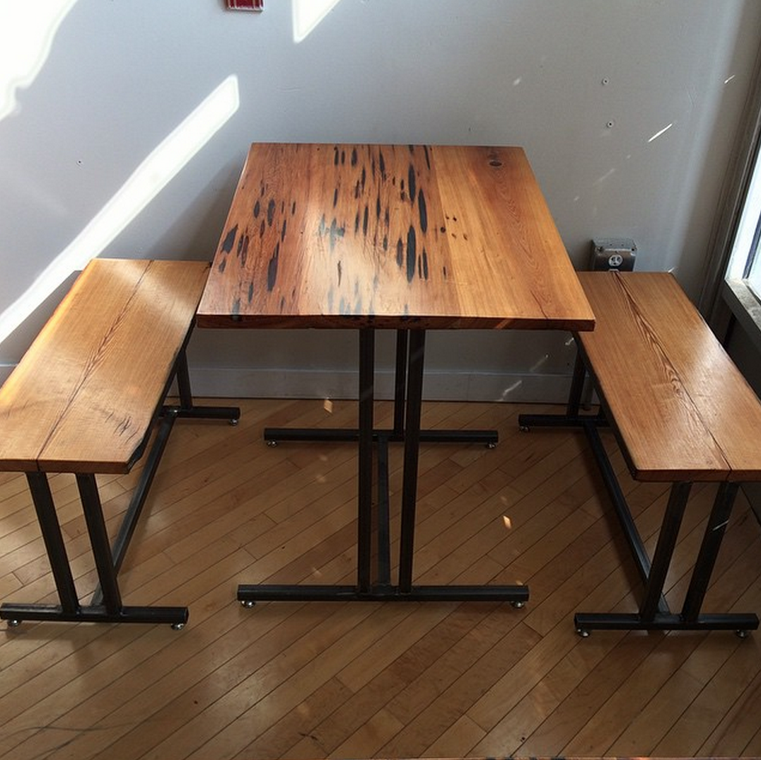 Crime and Punishment pecky cypress and steel table with long leaf yellow pine benches.