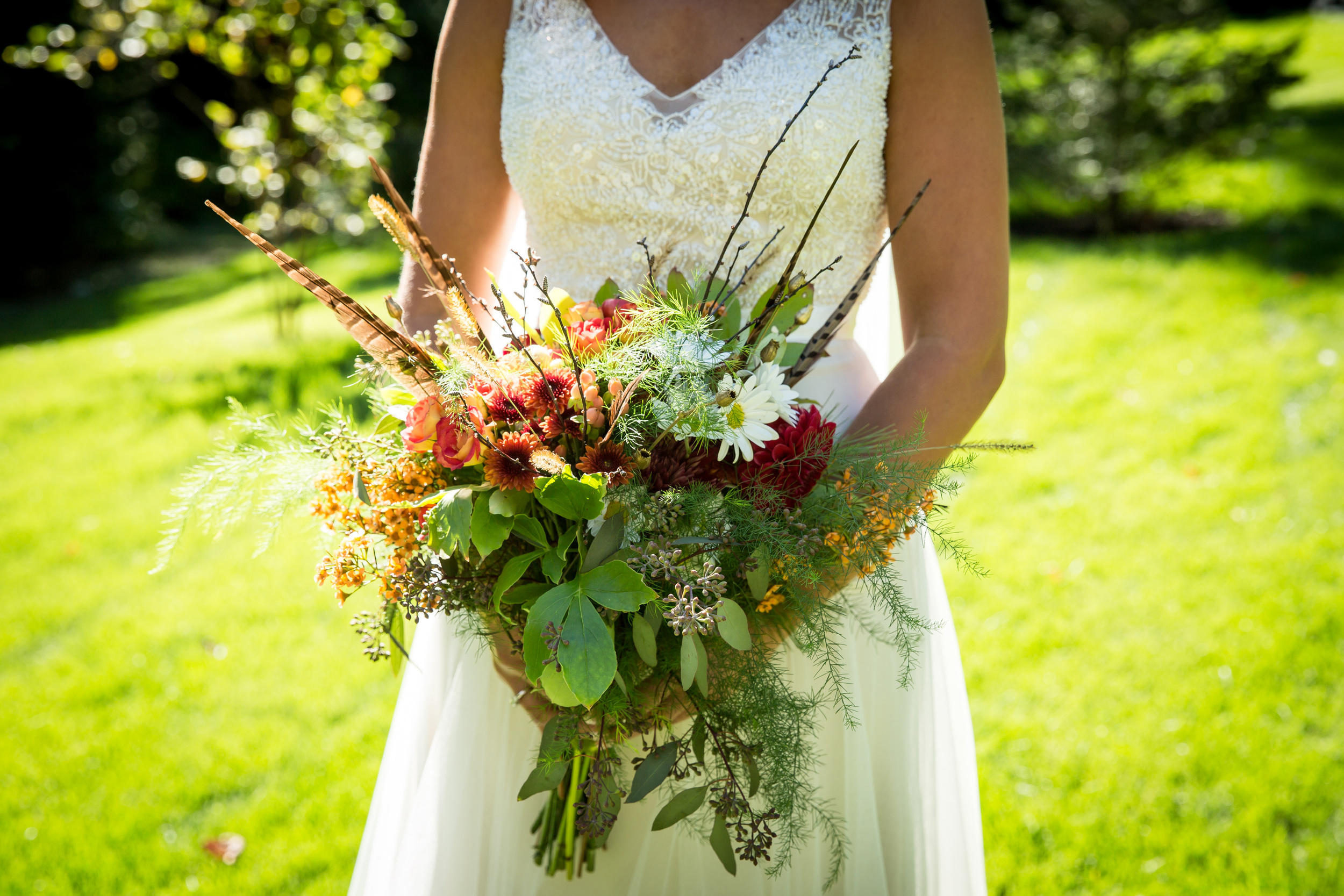 bridal_bouquet_pheasant_feathers_and_fowers