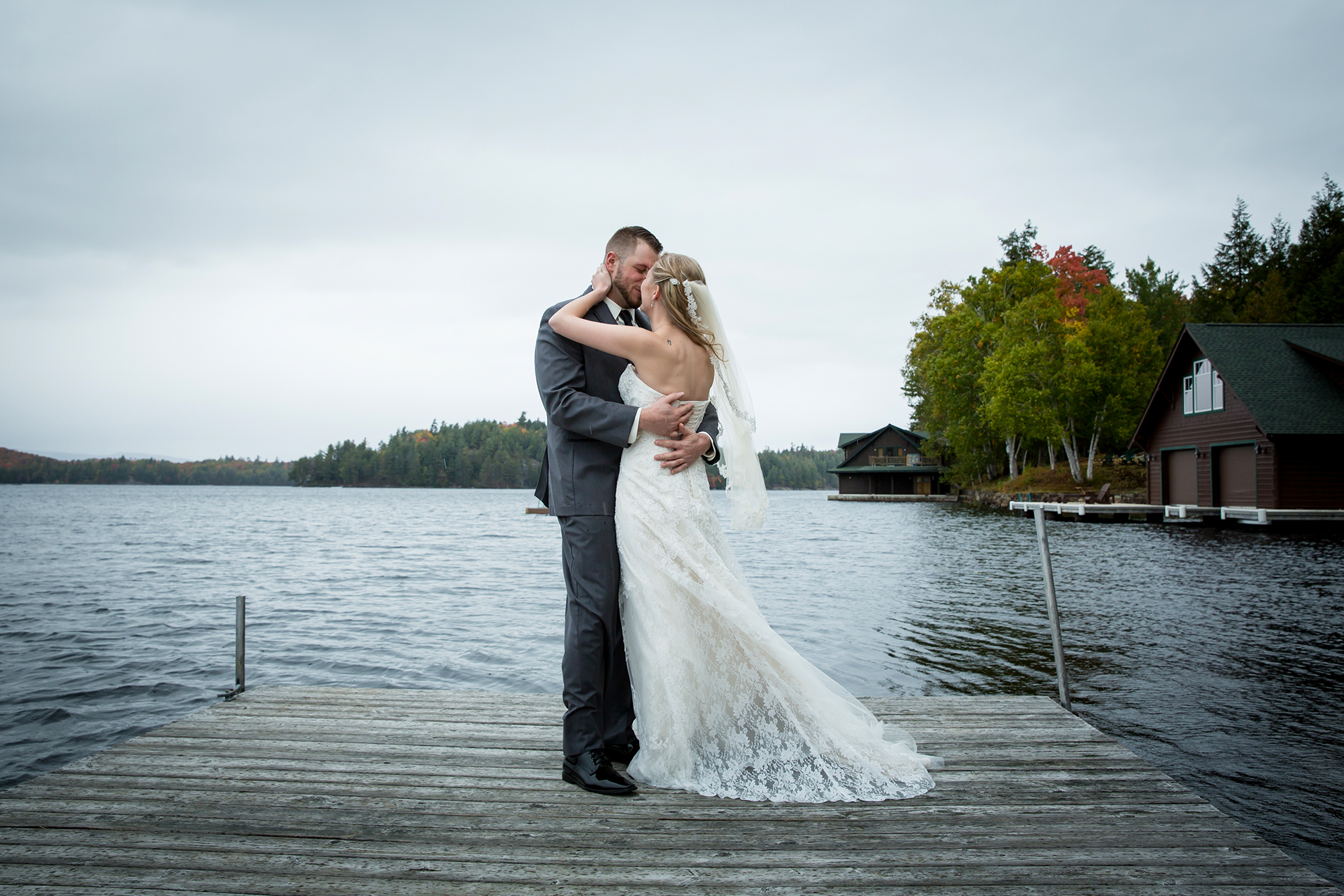 adirondack_lake_wedding_dock_kiss