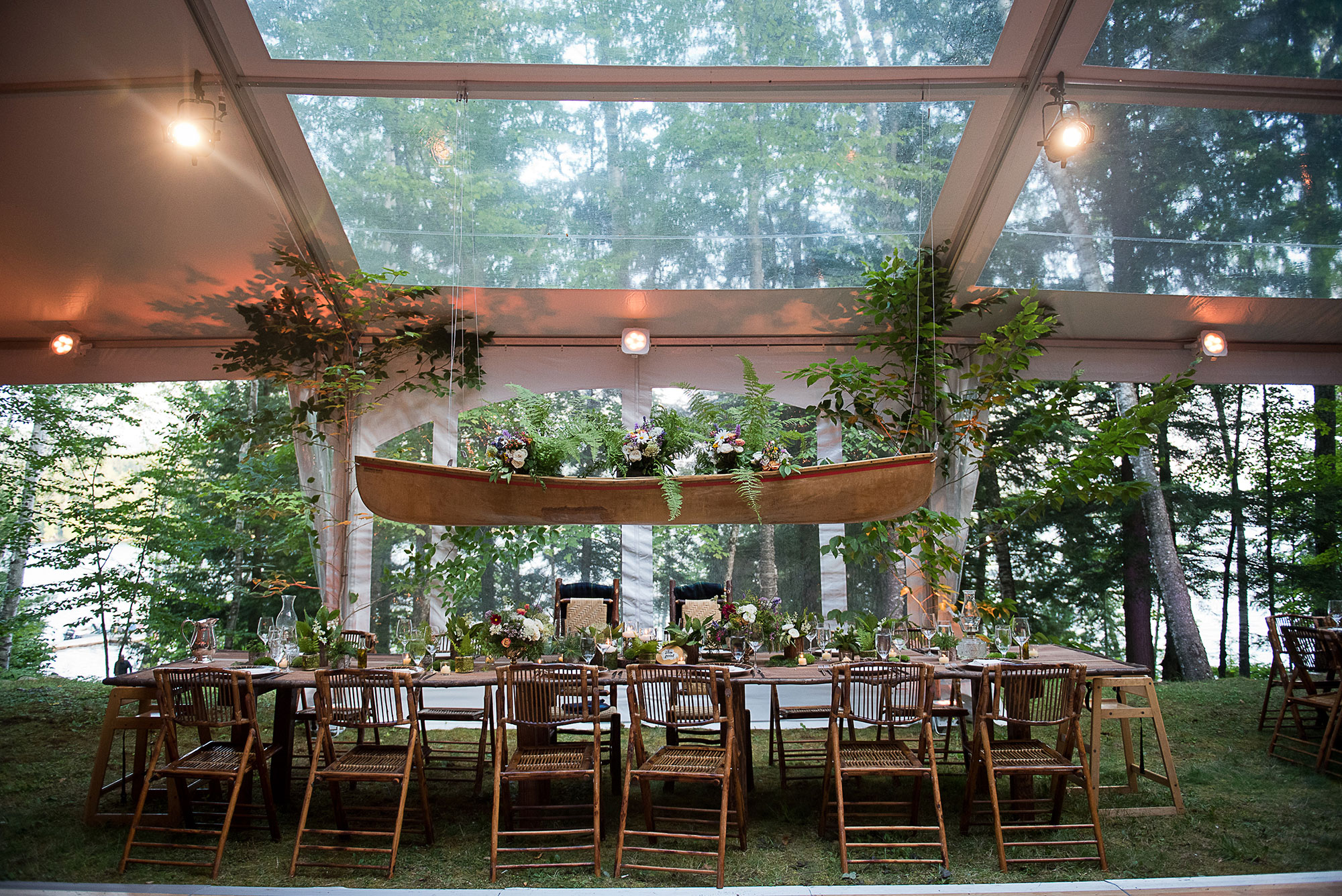 adirondack_wedding_tent_table_hanging_canoe.jpg
