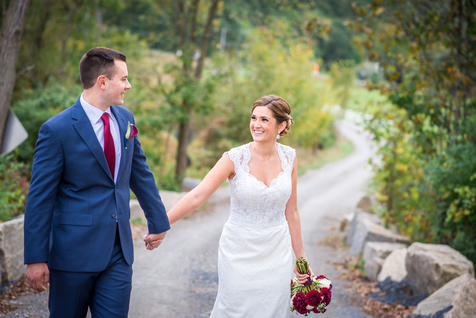 ross_kassie_wedding_winding_dirt_road_mountains.jpg