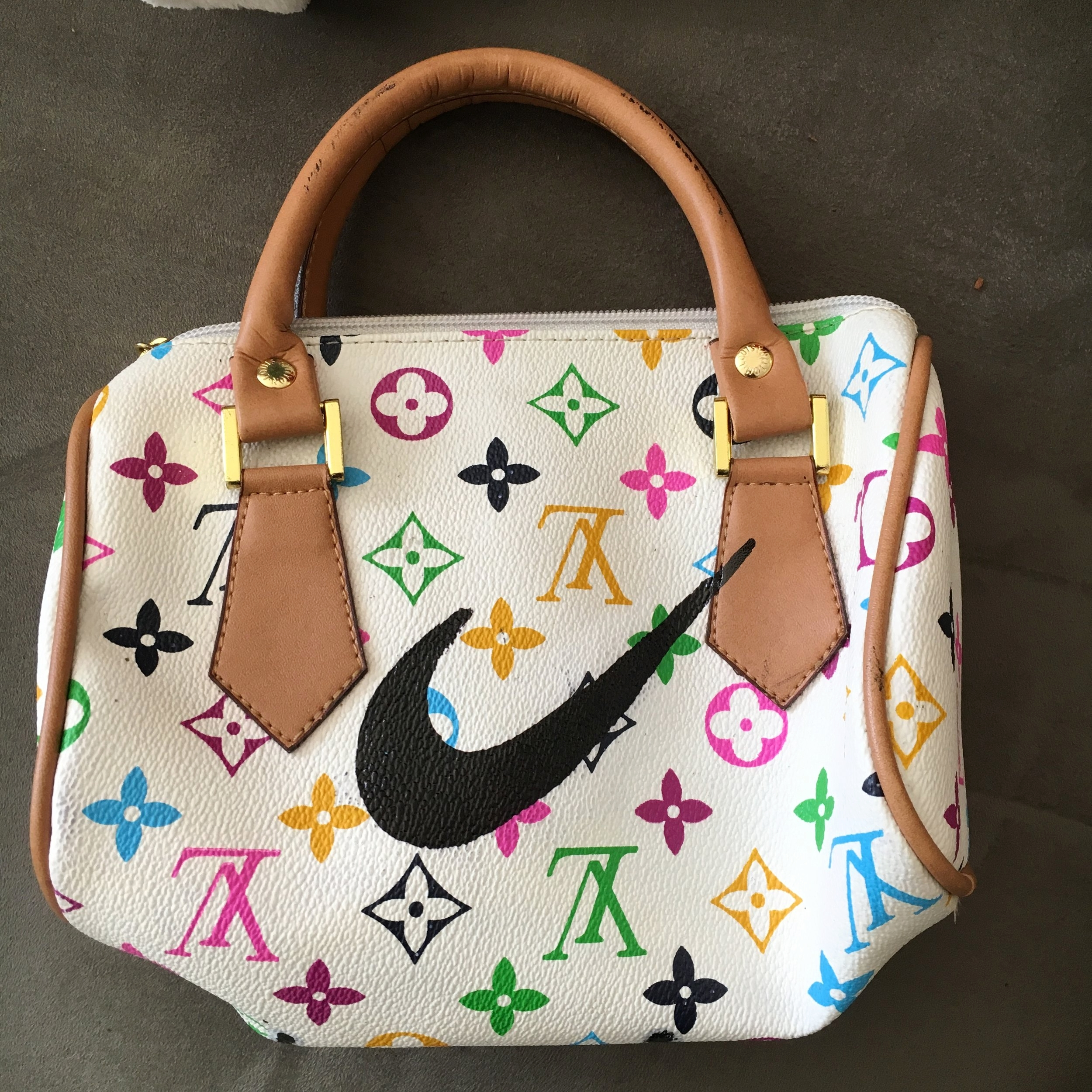 Just Do It, 2016  Enamel-based ink on fake Louis Vuitton purse