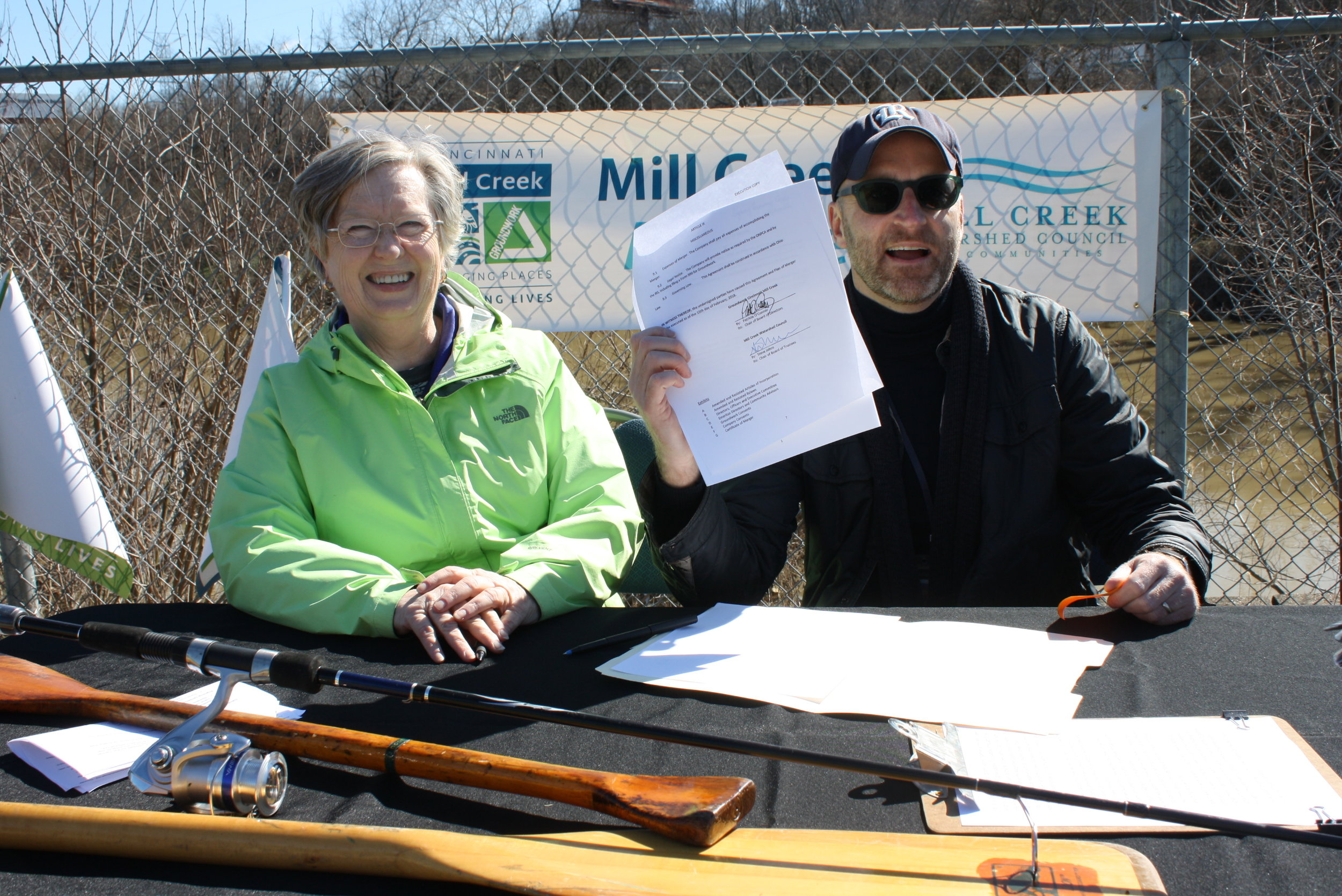 Mill Creek Alliance - press conf - Pat & Steve with document.JPG