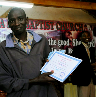 Harrison on his graduation day at Banana Hill Baptist Church
