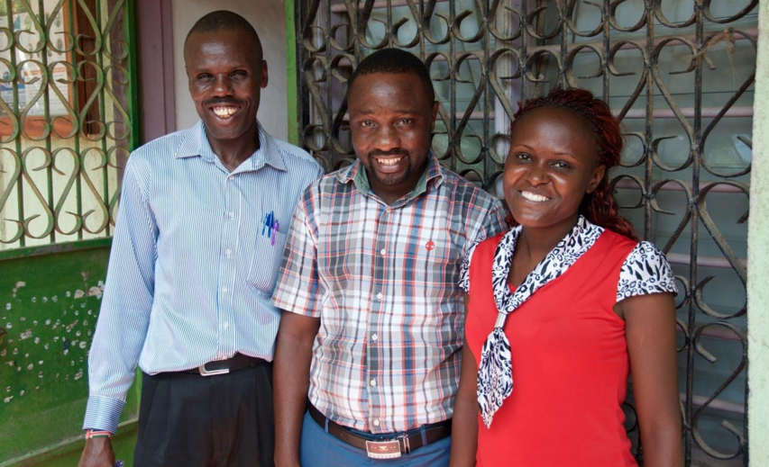 Francis, John, and Sarah at the CARE for AIDS center in Mikandani.