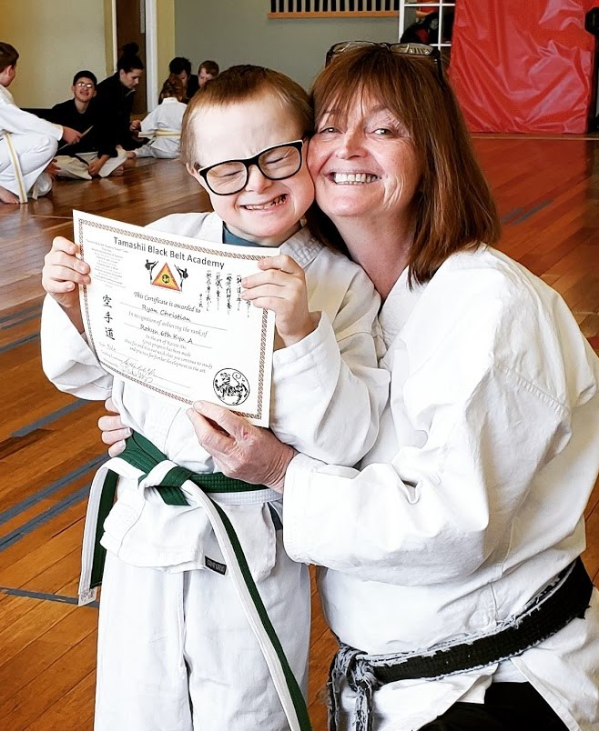 Ryan receiving his new belt and certificate!