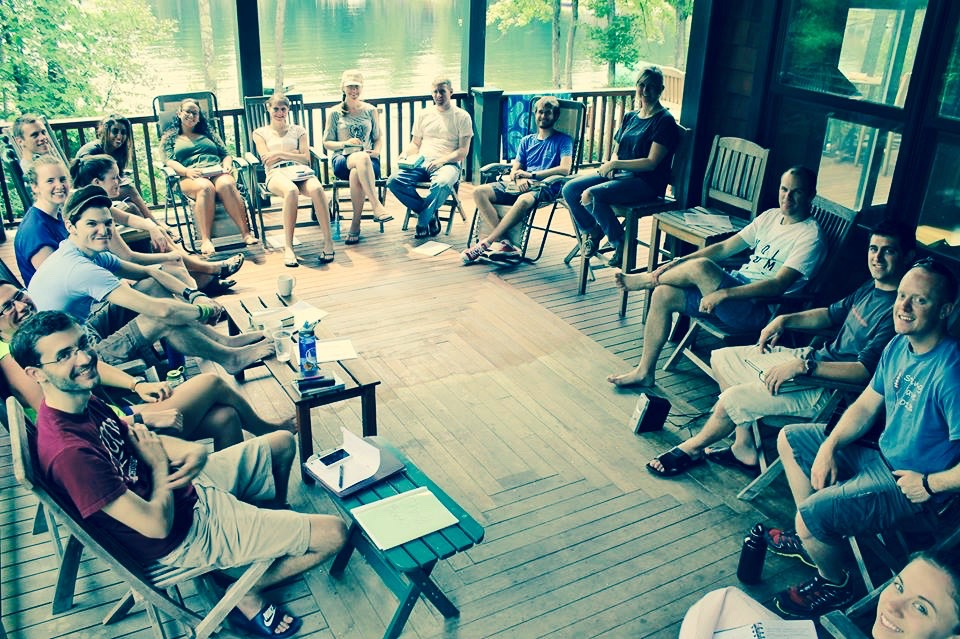 Community Group sitting on deck