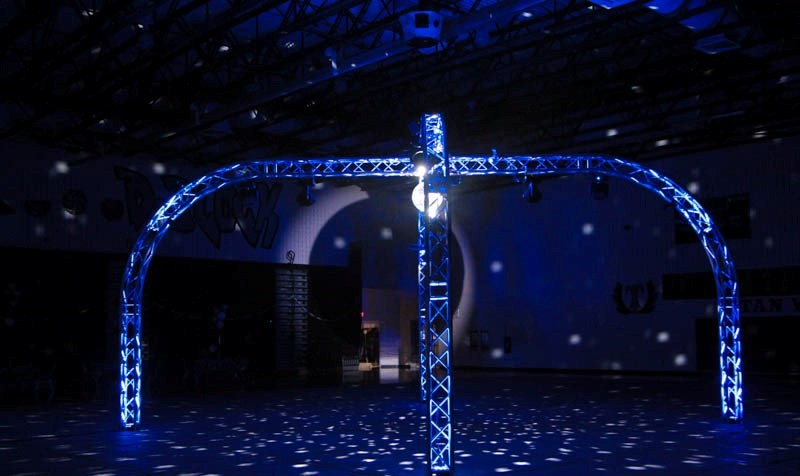 """The Spyder is our most awe inspiring package we offer as its name suggests. The Spyder covers a medium sized area and has a static ceiling of between 13 to 16 feet of overhead lighting design. The Spyder Dome comes with a 25ft X 25ft """"Spyder or Dome"""" shaped LED lit box truss suspended 13-16 ft (venue specific) over the dance floor."""