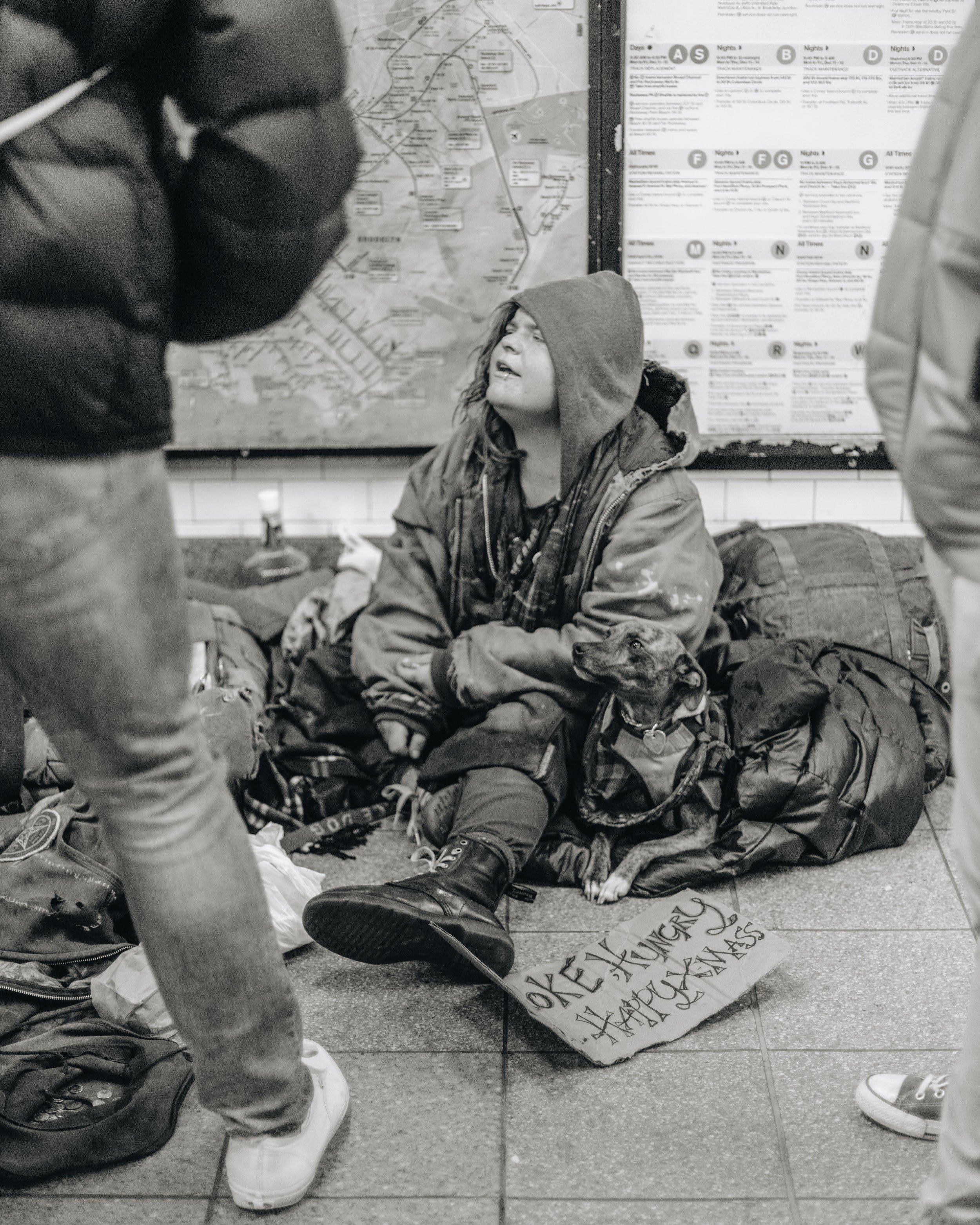 Union Square, NYC. Subway entrances are also a popular place for the homeless, rather protected from the elements and near a lot of foot traffic for potential donations.