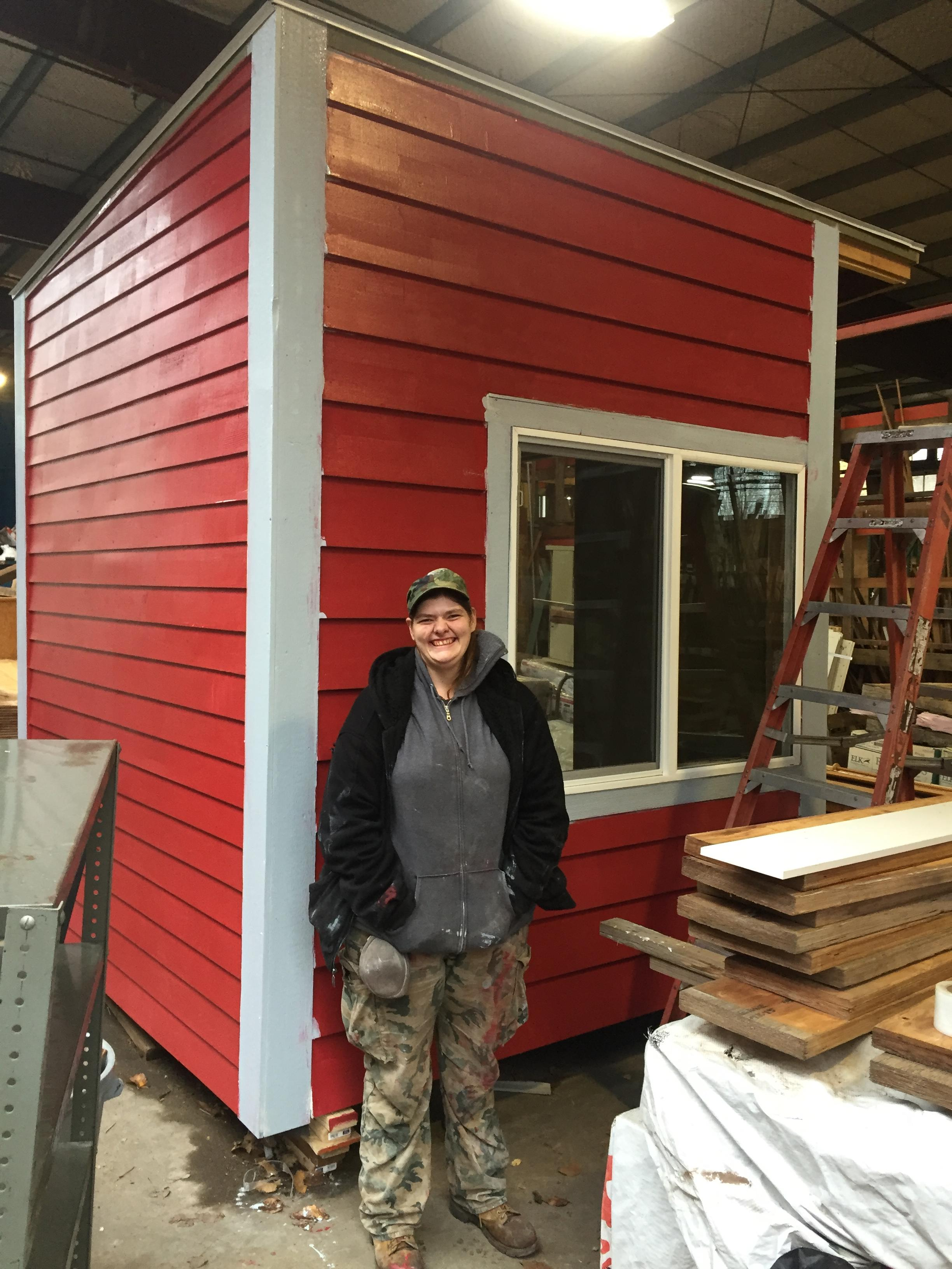 Loki with her tiny house built in the RBC lumberyard