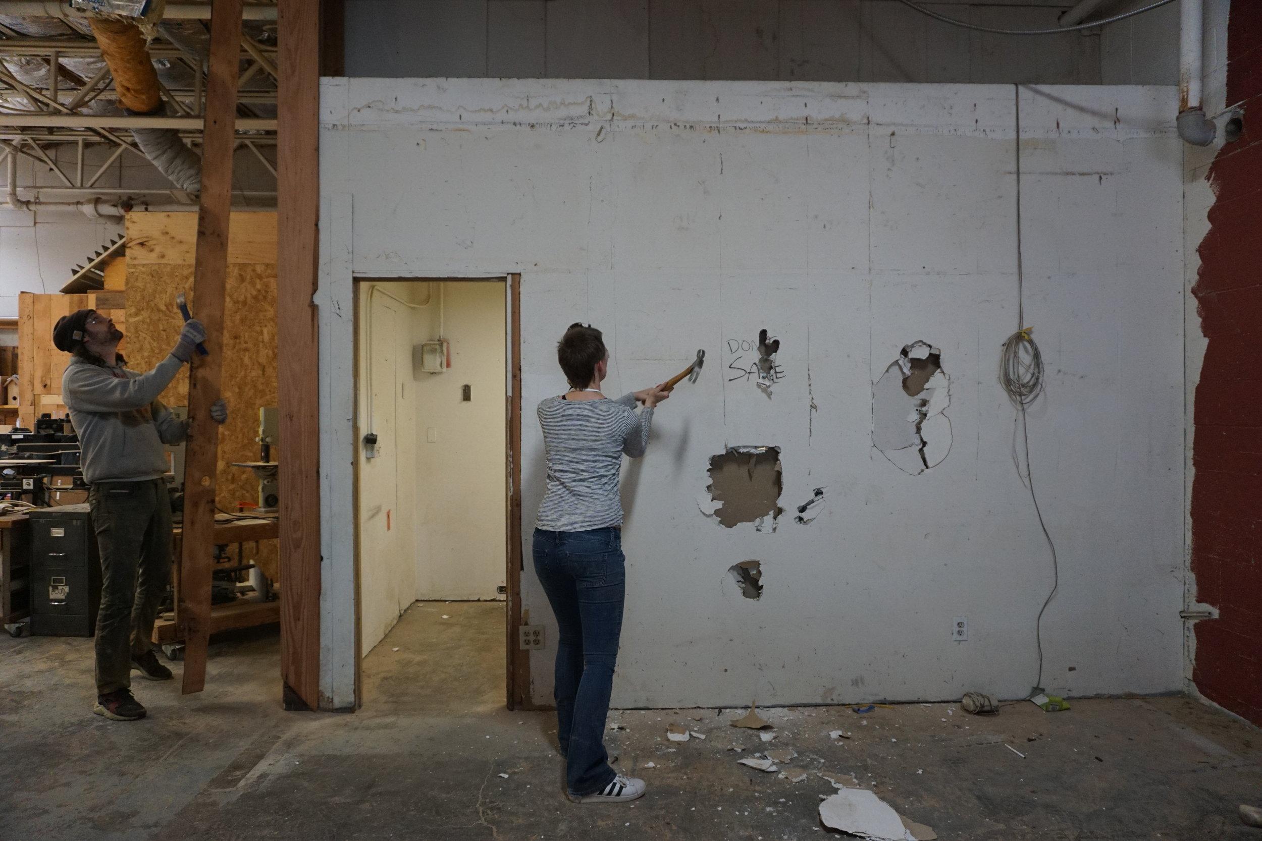 Volunteers deconstructing the office space.