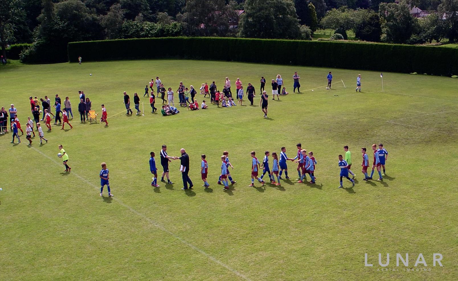 drone footage of soccer tournament northwest hands.jpg