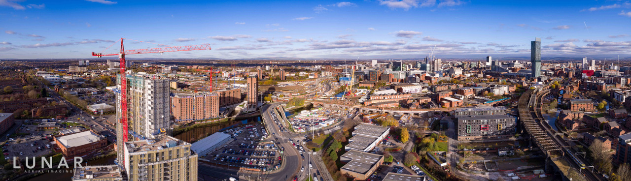 Drone footage showing panoramic view of One Regent Apartments in Manchester.