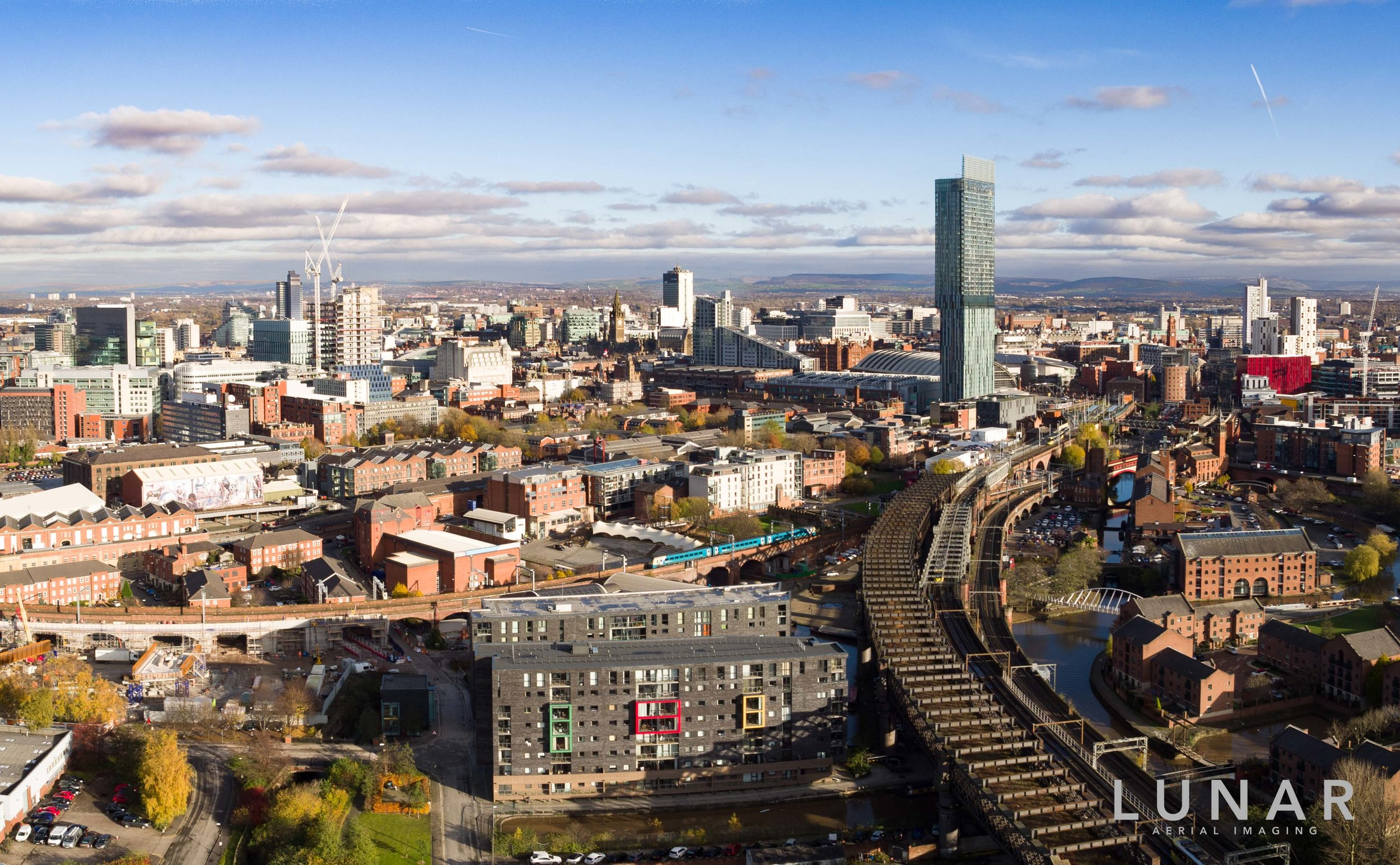 Looking over Manchester train network with cityscape