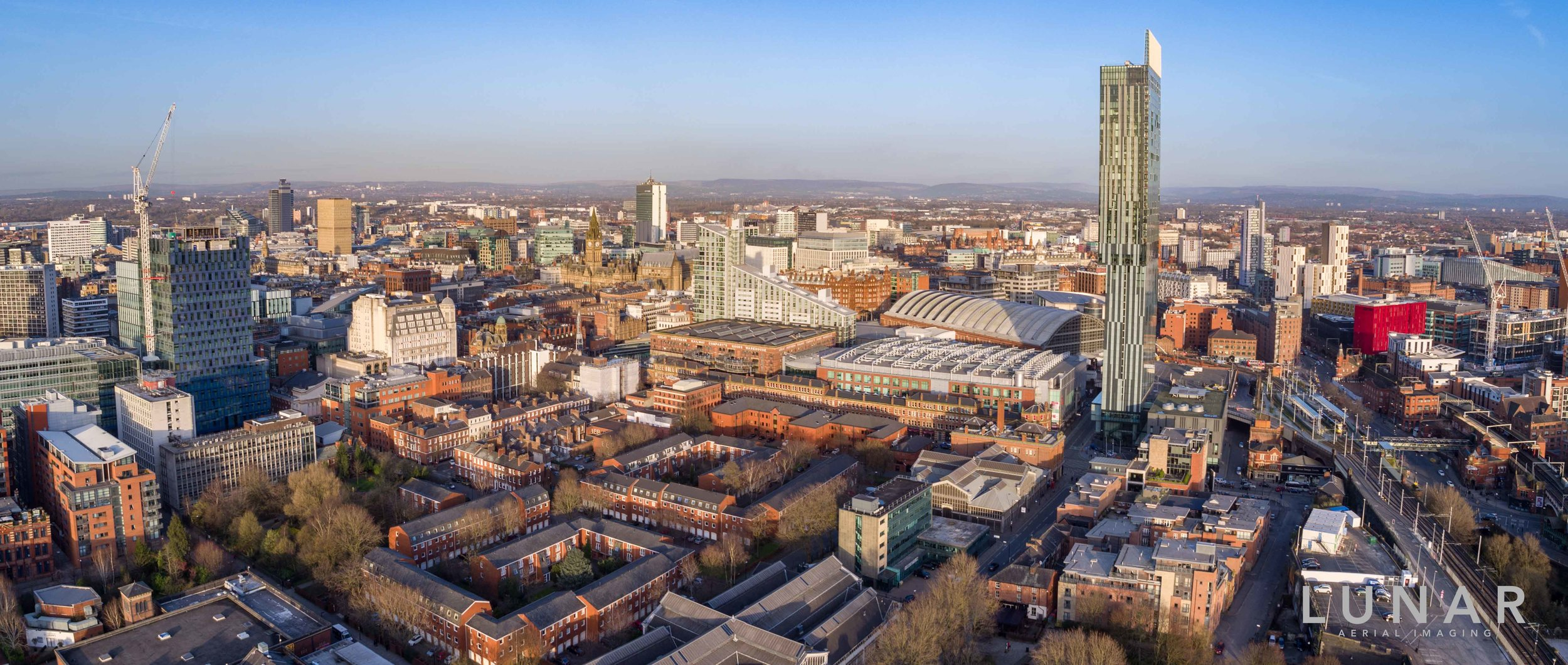Wide aerial cityscape of Manchester