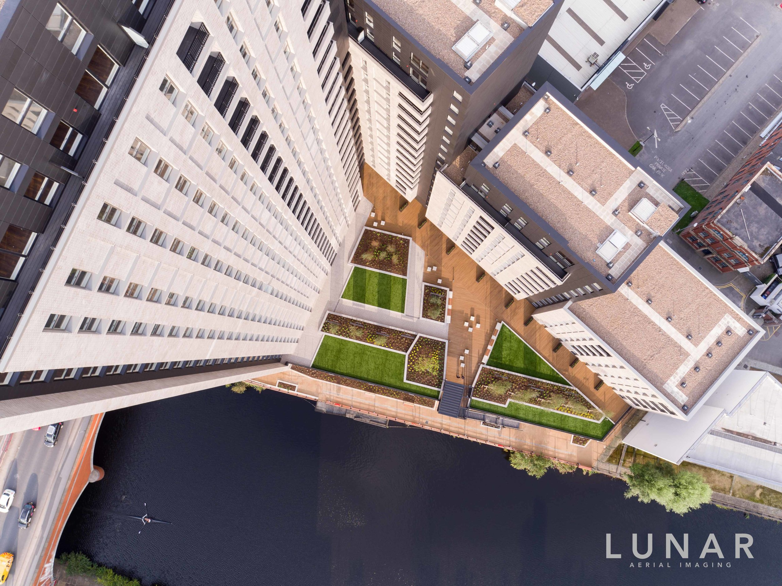 Drone photograph of Manchester apartment's courtyard by water