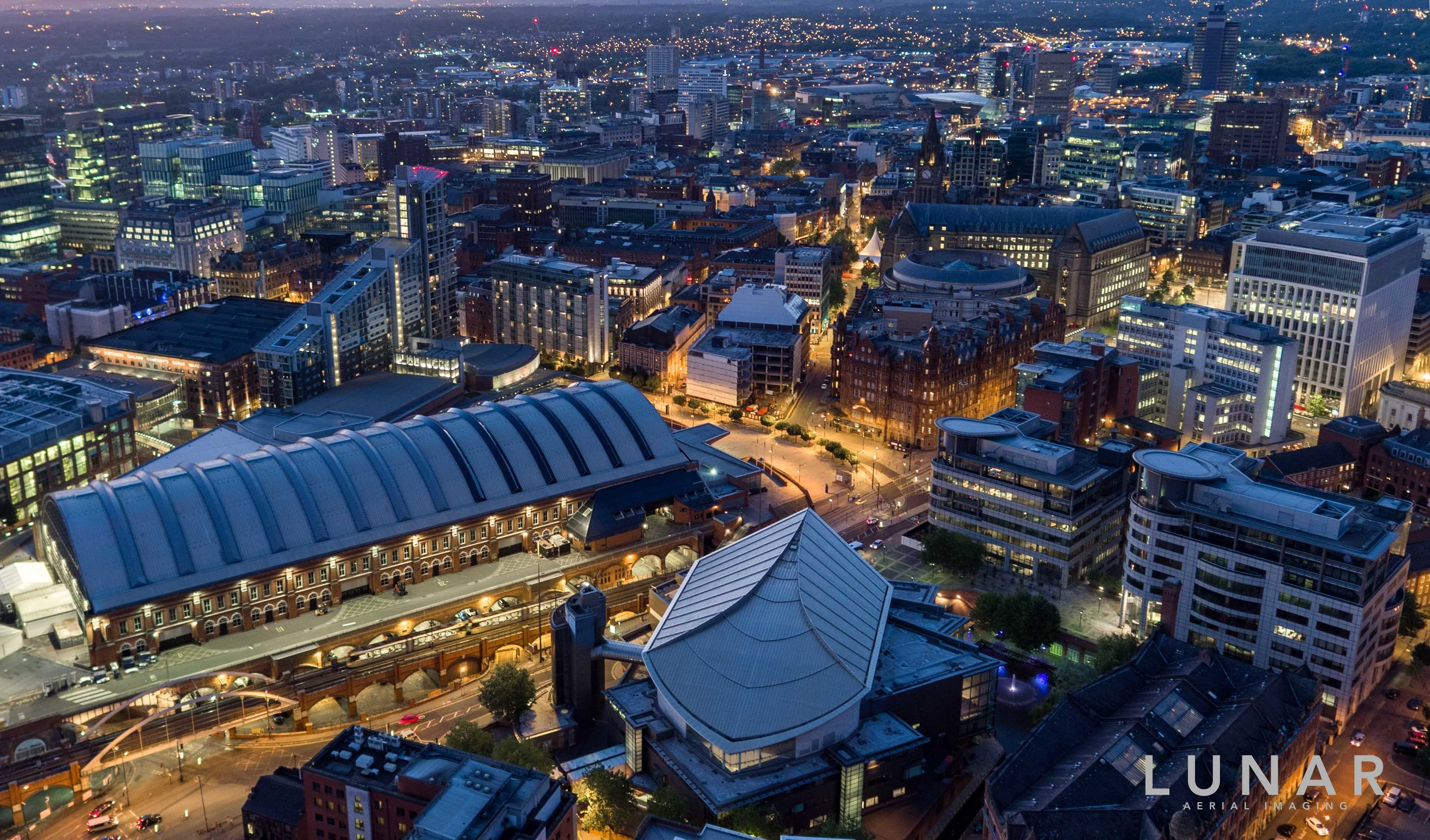 Aerial photo at night of Manchester including Manchester Central and he Bridgewater Hall