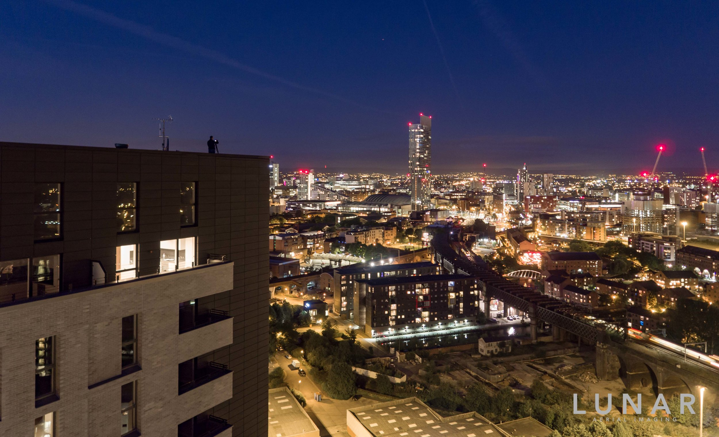 manchester, night time photographer on roof.jpg