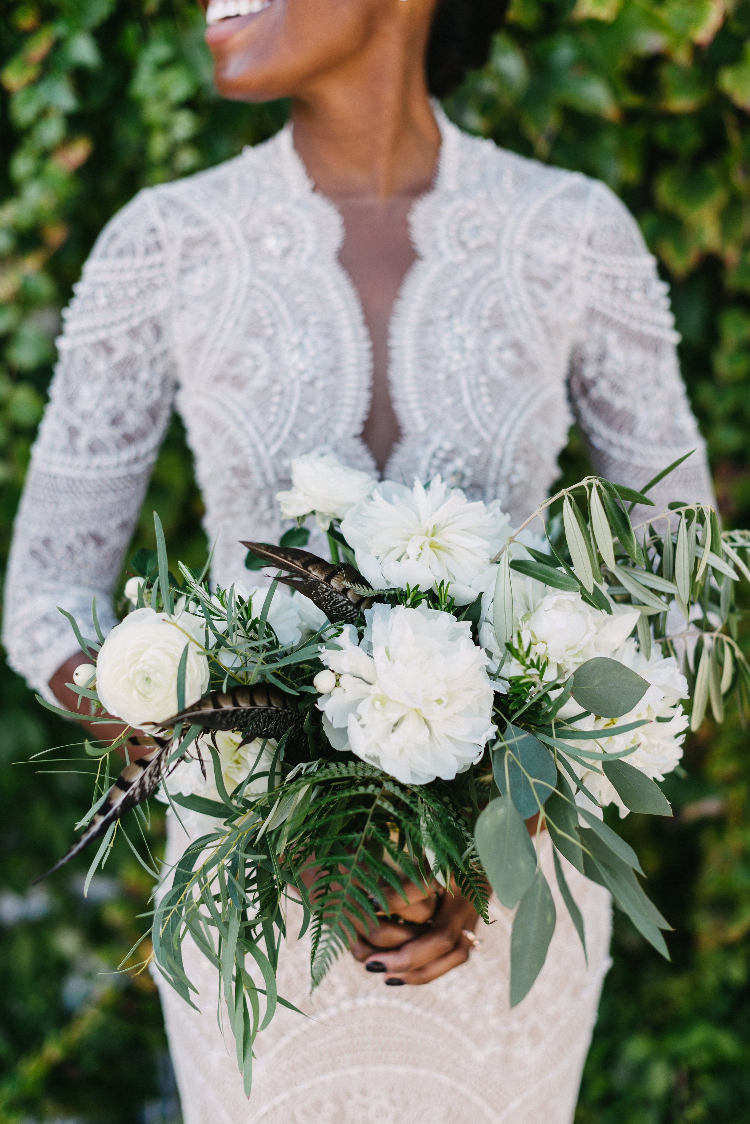 white and green organic bridal bouquet with feathers.jpg