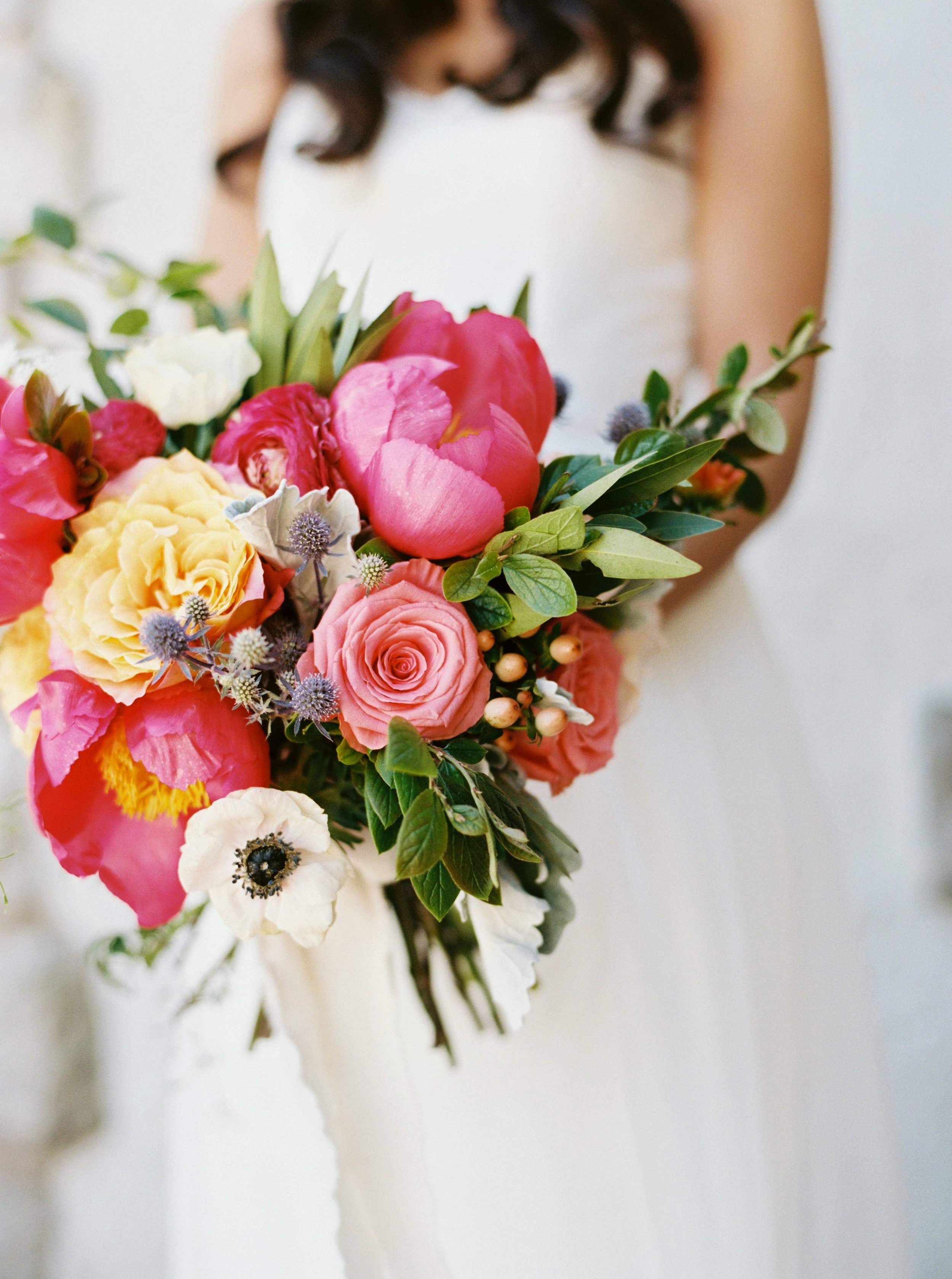 coral and peach wedding bouquet with peonies.jpg
