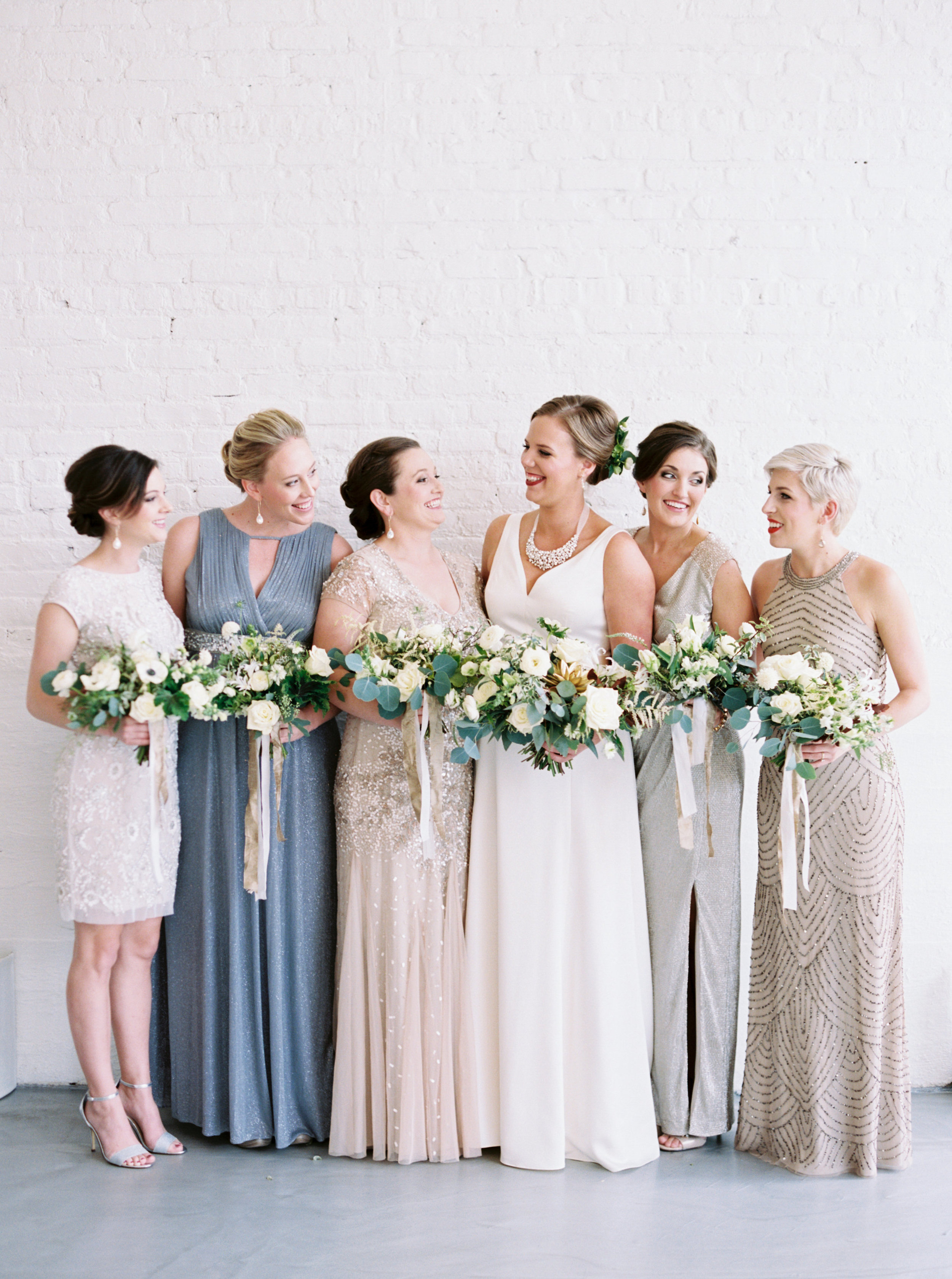 neutral metallic bridesmaid with bouquets.JPG