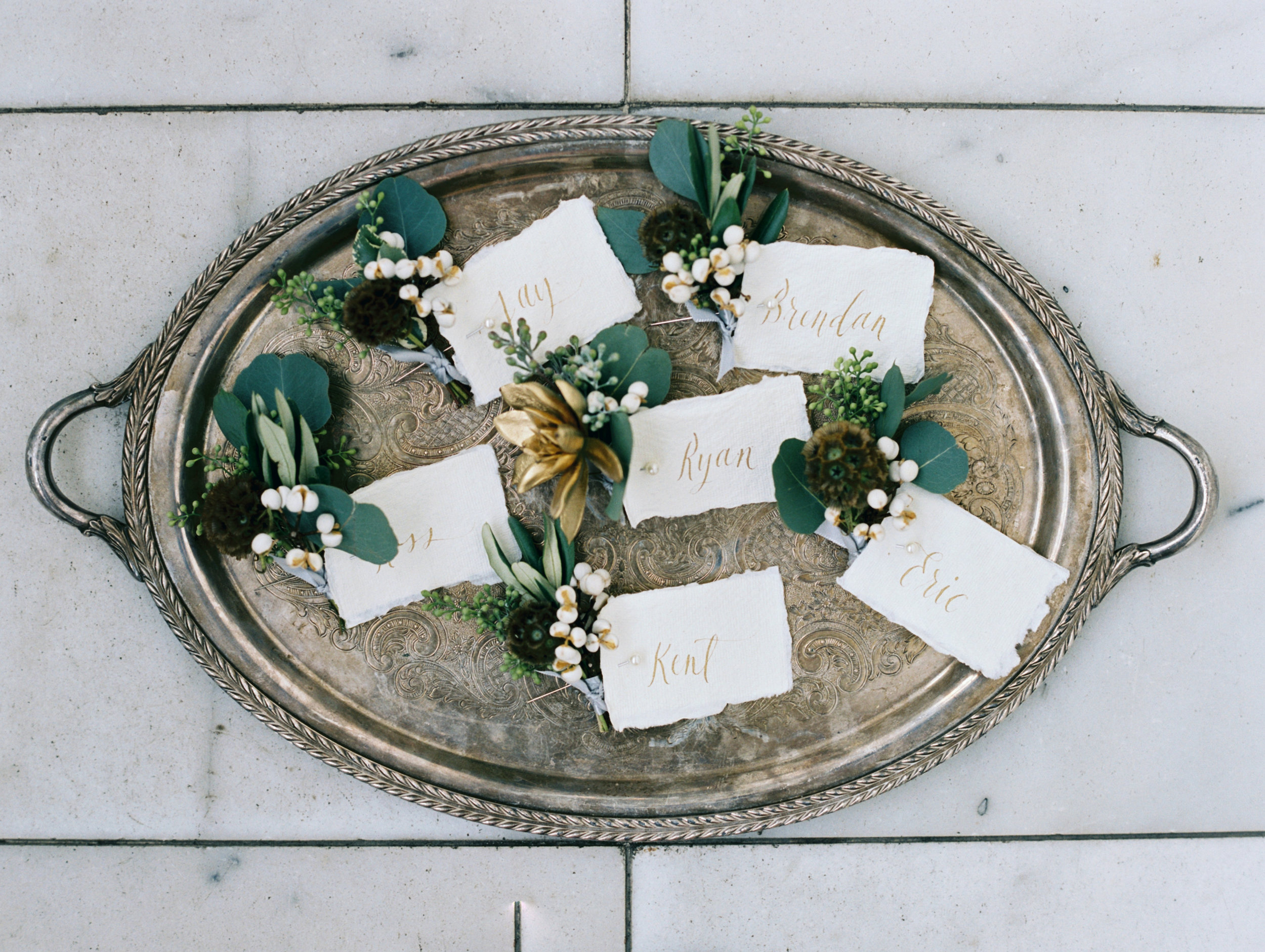 metallic and greenery boutonnieres.JPG