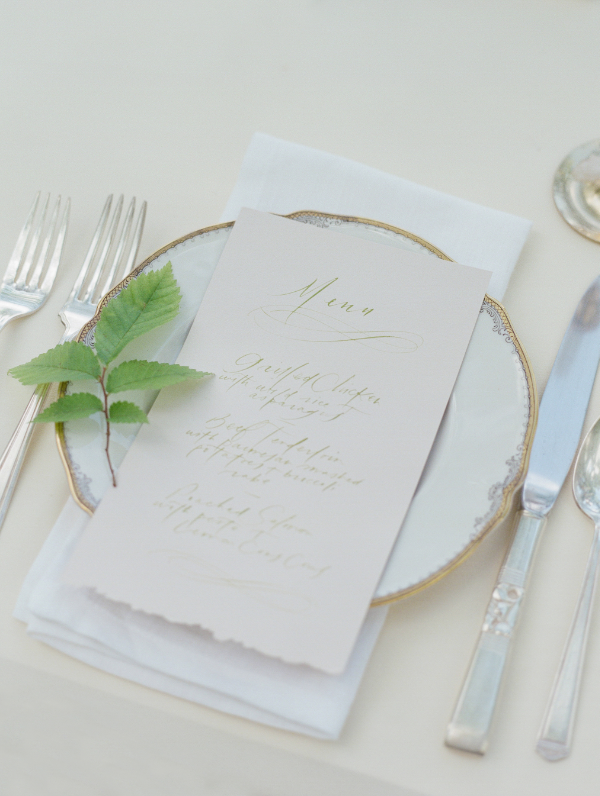 wedding calligraphy menu in gold and white