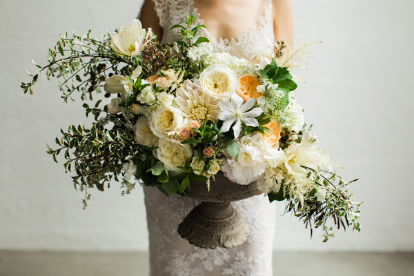 peach, white and soft yellow flower centerpiece by Foraged Floral in Portland, Oregon