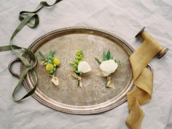 green, yellow and white wedding boutonnieres
