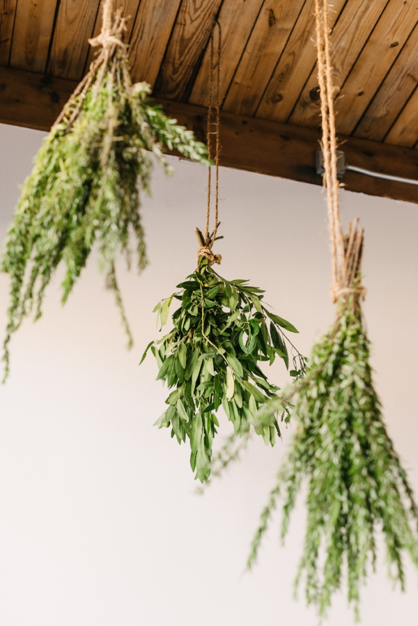 herb and greenery ceiling installation at wedding by Foraged Floral