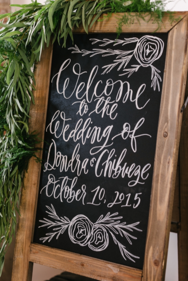 modern calligraphy wedding chalkboard with greenery garland by Foraged Floral