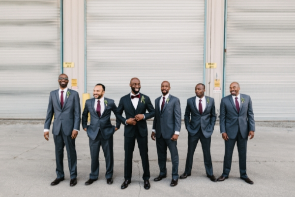 unique groomsmen photo in industrial setting