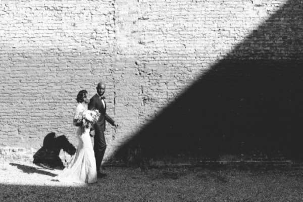 unique wedding day portrait ideas for bride and groom outside, and in black and white
