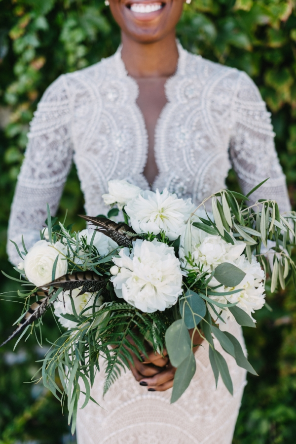 organic wedding bouquet with white and green flowers of peonies, olive branch, ranunculus and rosemary by Foraged Floral