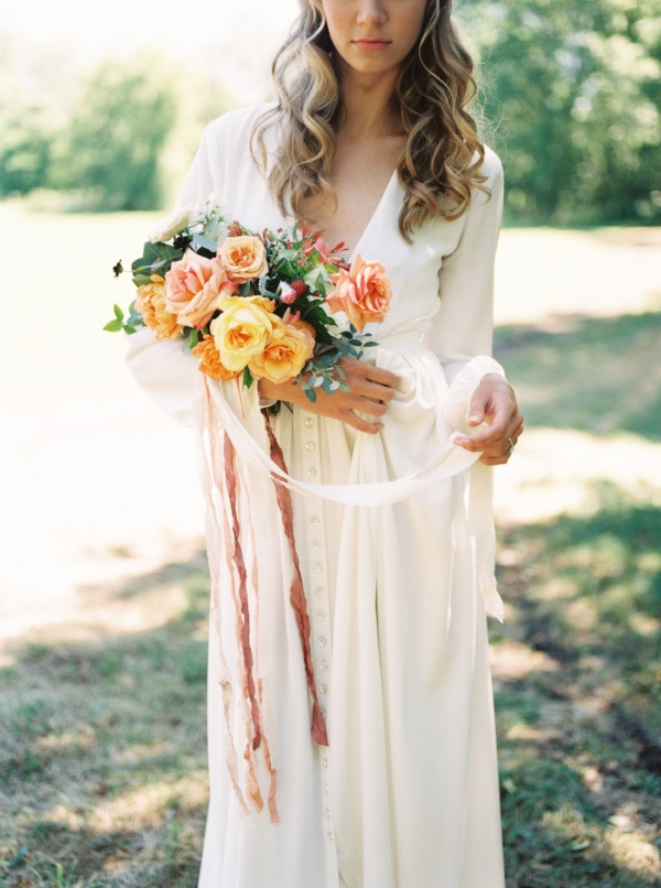 wedding bouquet with garden roses in peach, yellow, orange and red for late summer outdoor wedding by Foraged Floral in Portland, Oregon