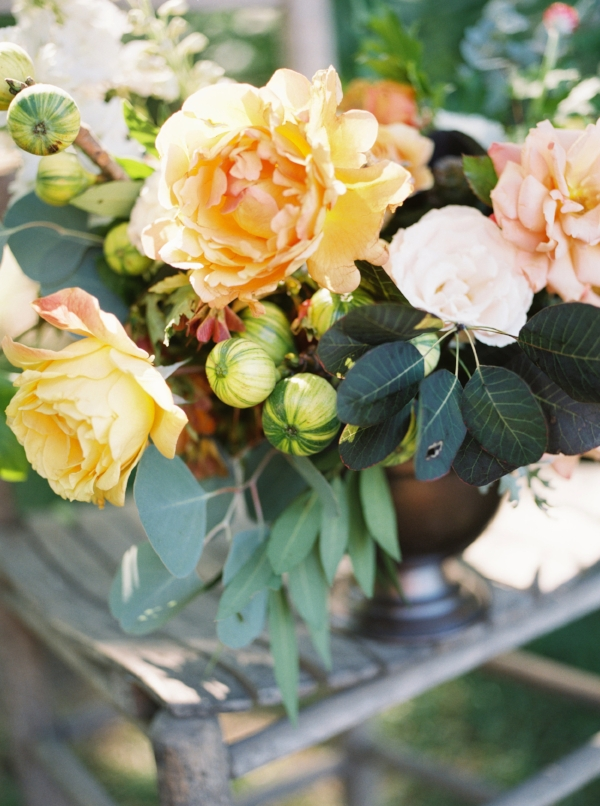 floral wedding centerpiece with garden roses in peach, yellow, orange and red for late summer outdoor wedding by Foraged Floral in Portland, Oregon