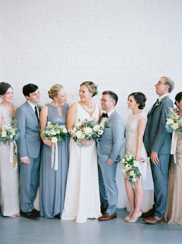 Wedding party fashion for metallic themed winter wedding. Each carried a bouquet of white and green wedding flowers and hanging gold and white silk ribbons by Foraged Floral in Portland, Oregon.