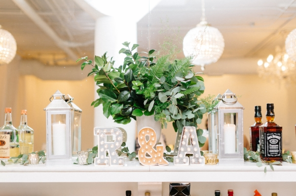 Unique wedding decor for indoor winter wedding at Room 1520 in Chicago with white and green flowers by Foraged Floral