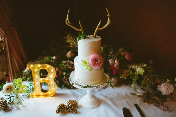antler wedding cake with coral and pink fresh flowers by Foraged Floral in Portland, Oregon