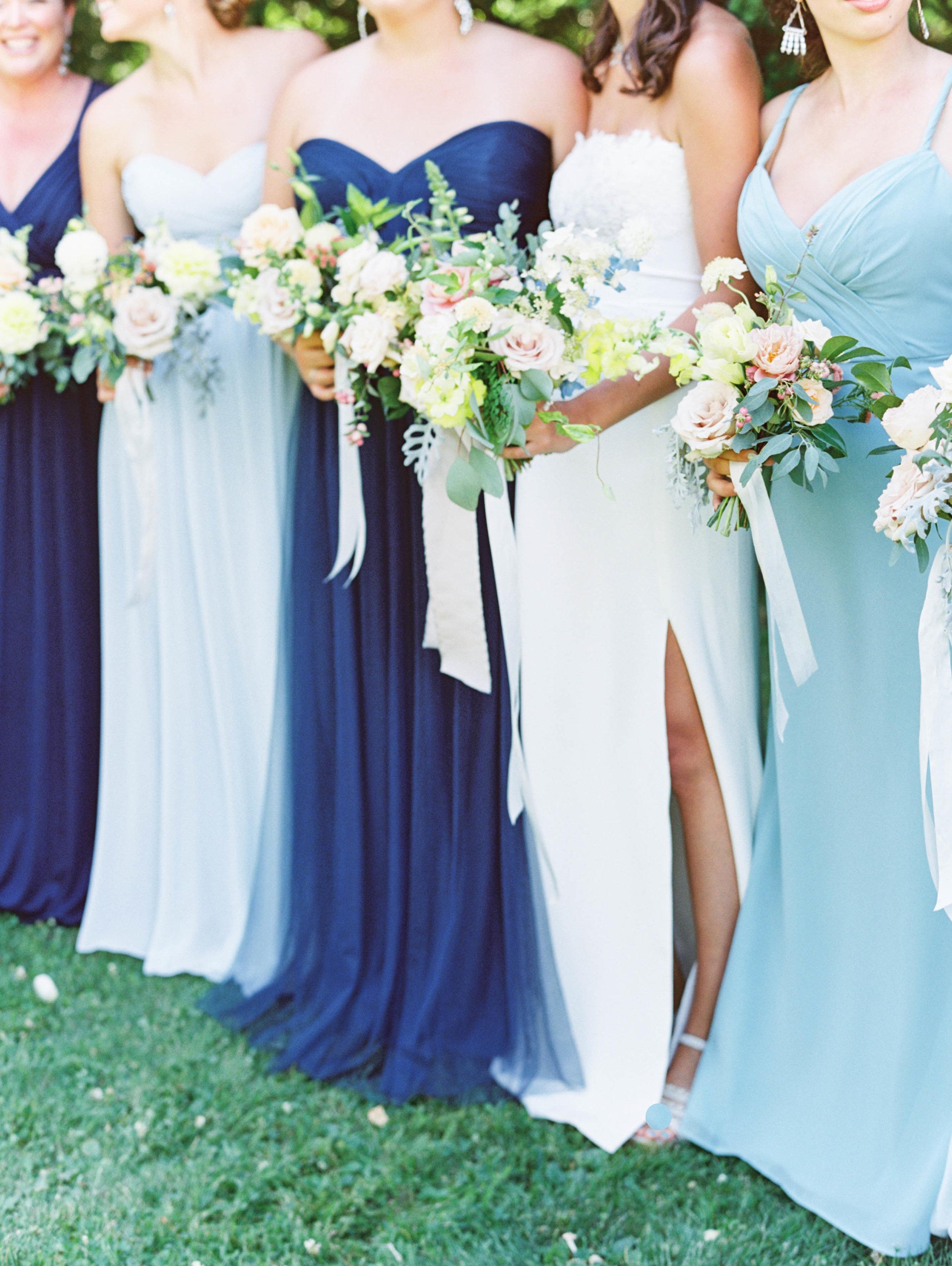 bridesmaids in blue for outdoor oregon wedding at mt hood organic farms.jpg