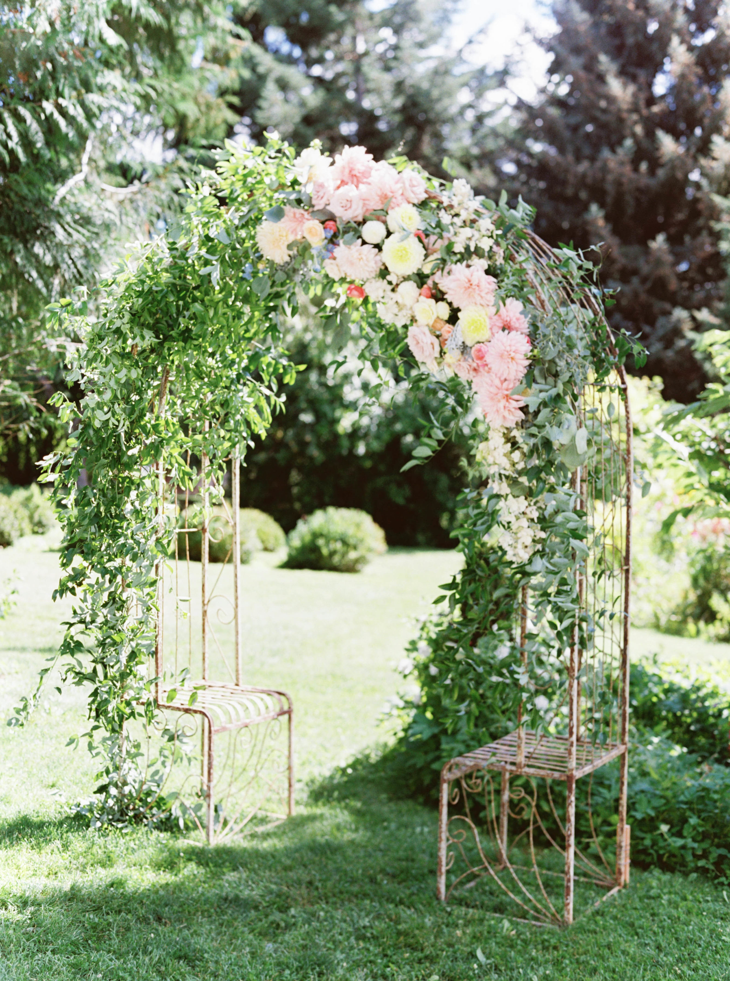 wedding ceremony arch with cafe au lait dahlias and greenery by foraged floral in OR.jpg