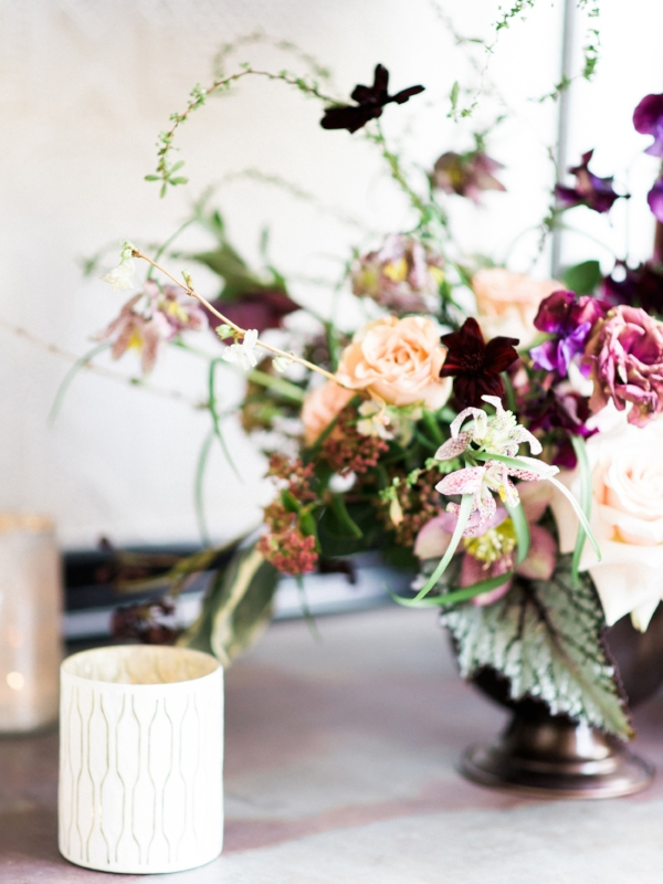 Blush, purple and white wedding flowers by Foraged Floral in Portland, Oregon, with ranunculus and hellebores