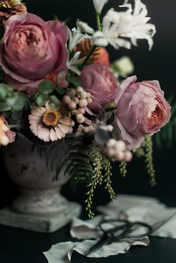 Peach and pink summer flower centerpiece by Foraged Floral with zinnias, dahlias, snowberry and garden roses