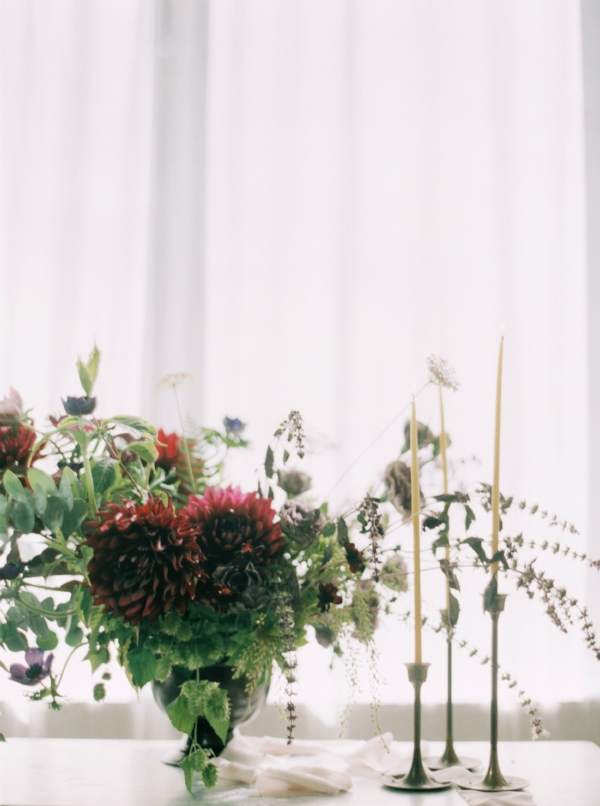 Burgundy and purple flower centerpiece with dahlias and anemones by Foraged Floral