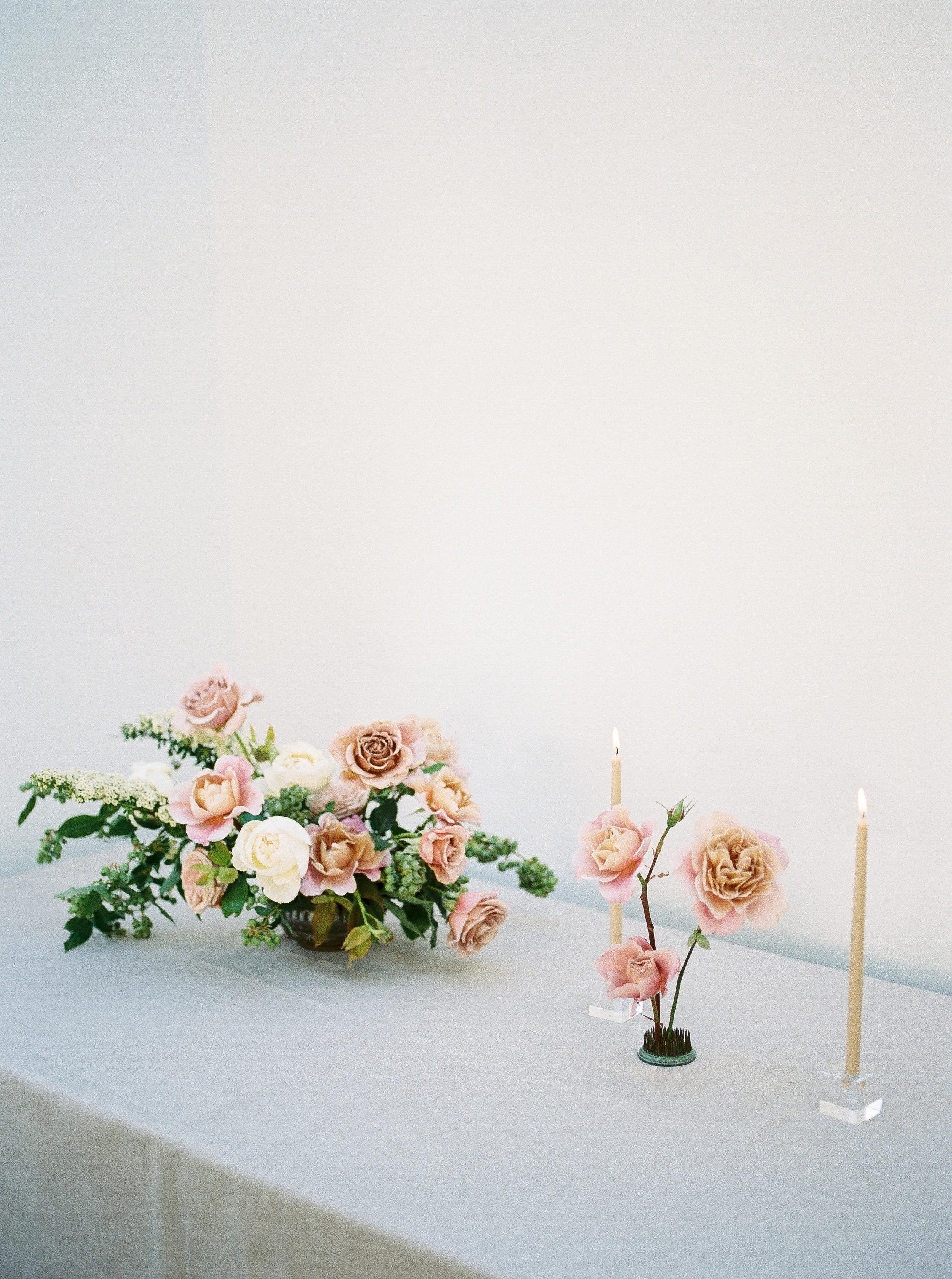 wedding centerpiece with garden roses and spirea.jpg