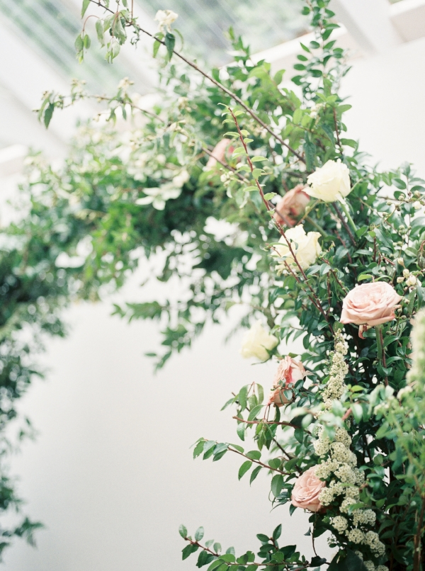 Greenery wedding arch with mauve, white and ivory flowers including spirea and peonies by Foraged Floral