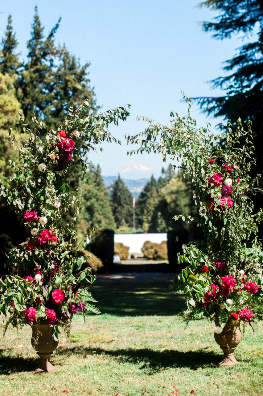 fine-art-wedding-florist-foraged-floral-lewis-and-clark-college-wedding-ceremony-arch-with-peonies-and-dahlias-for-jewel-toned-wedding.jpg