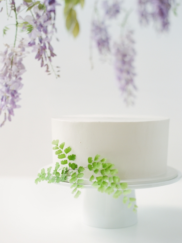 Unique wedding cake inspiration with fresh flowers by Foraged Floral, purple wisteria backdrop